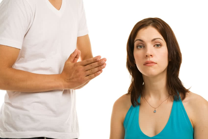 Young woman and young man showing different emotions. Concepts : pleading; disappointment; misunderstanding. White background.