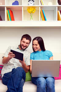 man and woman looking at the tablet pc