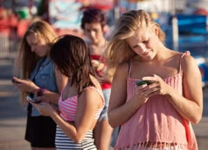 Serious Teenagers on Smartphones