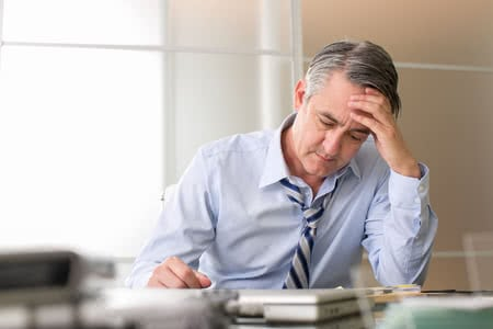 50080510 - frustrated stressed business man in an office