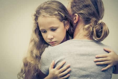 32429452 - portrait of one sad daughter hugging his mom