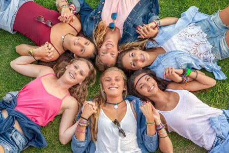 36452257 - happy smiling group of diverse girls at summer camp