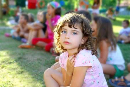 8289553 - girl spectator little children looking show outdoor park looking camera