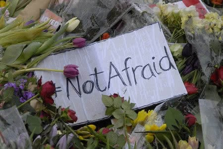 36886599 - copenhagen/denmark.  24 february 2015-memorial of late finn norgaard who was died in terrorest attacked krudttonder culture cafe  on osterbro on sunday night during debate meeting with swedish cartoonest here are various message with flowers including dan