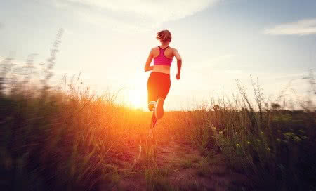 41800751 - young woman running on a rural road at sunset in summer field. lifestyle sports background